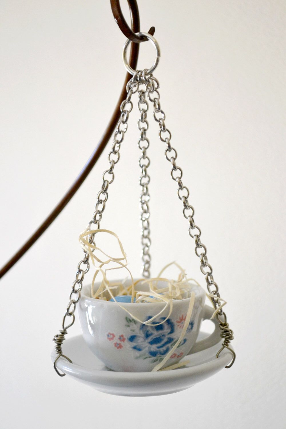 A personal favorite from my Etsy shop https://www.etsy.com/listing/193319875/blue-teacup-and-saucer-ornament-1