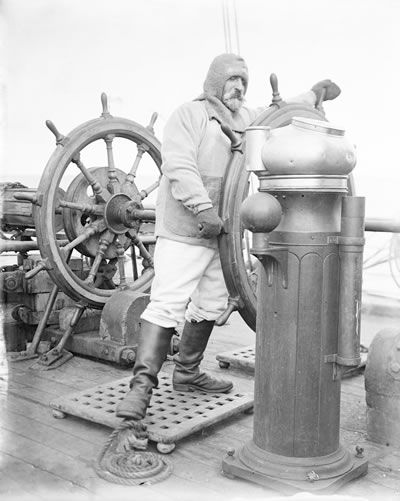 Mortimer McCarthy, able seaman, shown at the wheel of Captain Scott's ship Terra Nova