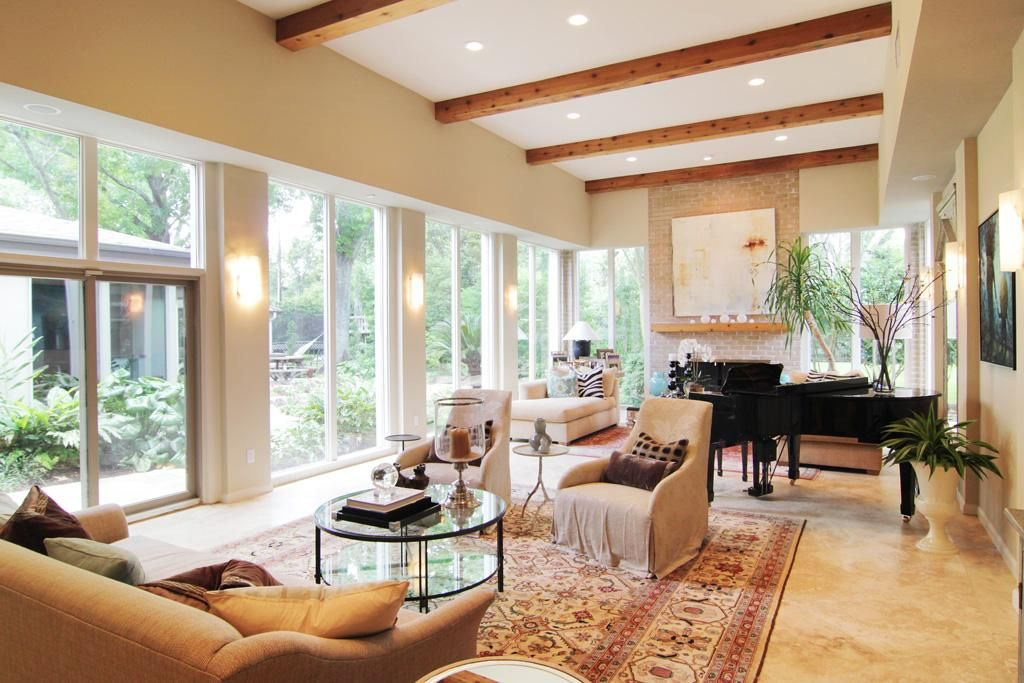 Great room with high ceilings, fireplace, travertine floors. Overlooks incredible backyard.