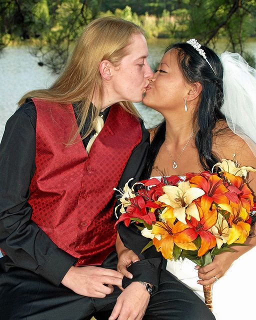 A female couple kiss after saying their vows .     Loving couple