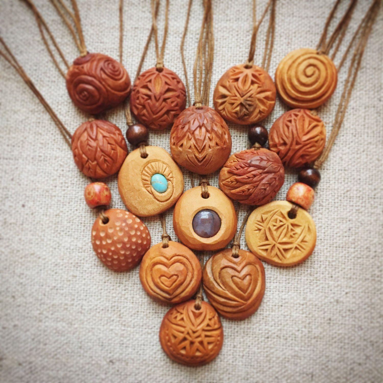 Hand carved avocado stone necklace. #woodcarvingtoo