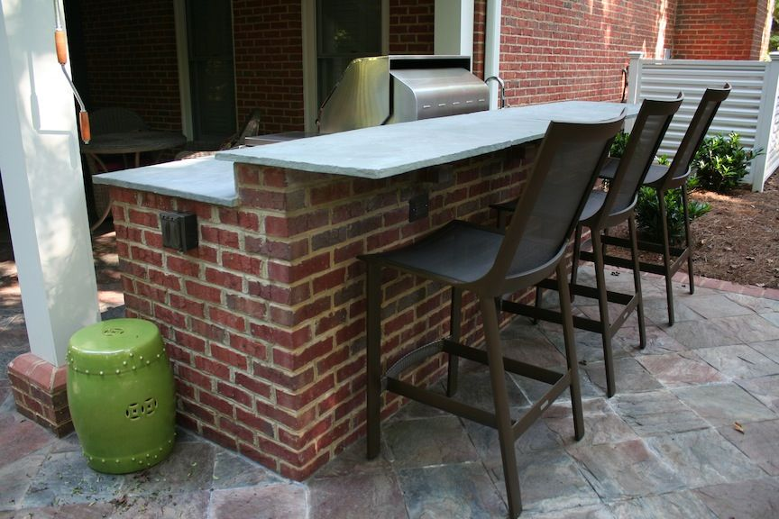 Red Brick Outdoor Kitchen With Raised Seating Bar Outdoor