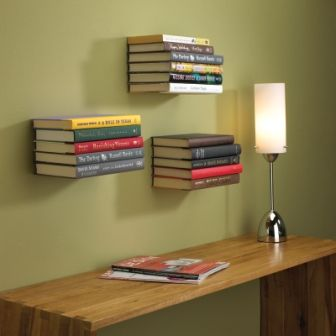 floating shelves made from books and an L bracket