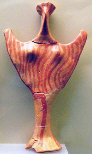 Abstract figurine in gesture of invocation or benediction,  painted with red ochre swirls. Large numbers of this type  have been found in Mycenaean sites, including Troy.