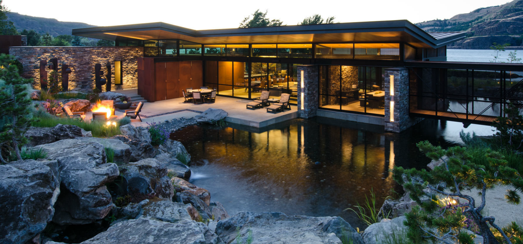Stone and cedar clad mid century modern pacific northwest for Pacific northwest homes