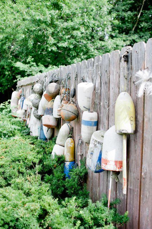 An assortment of boat buoys on Nantucket island.