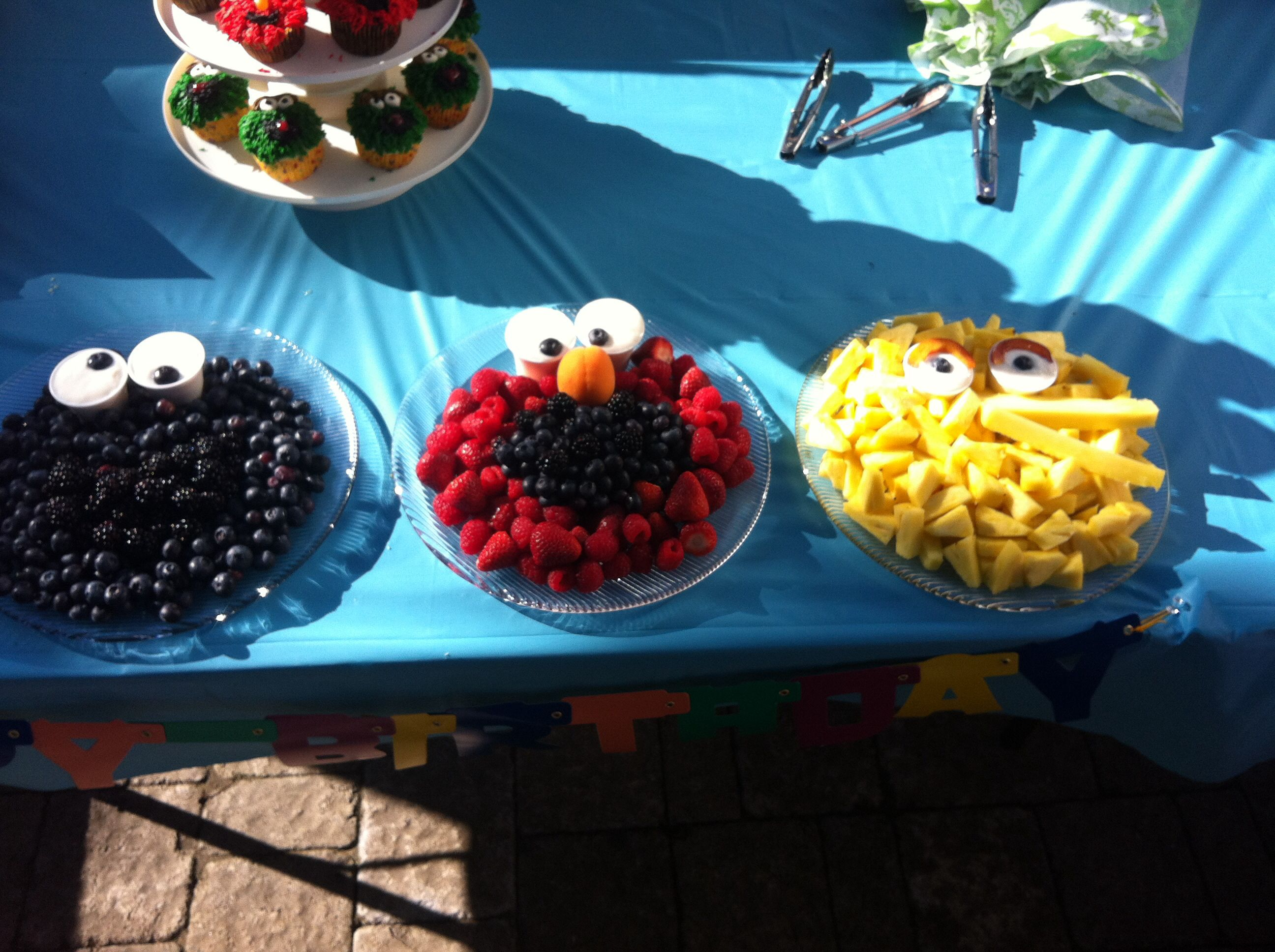 Sesame Street fruit plates - blueberries, raspberries, strawberries, blackberries and pineapple. And yogurt dip for the eyes.