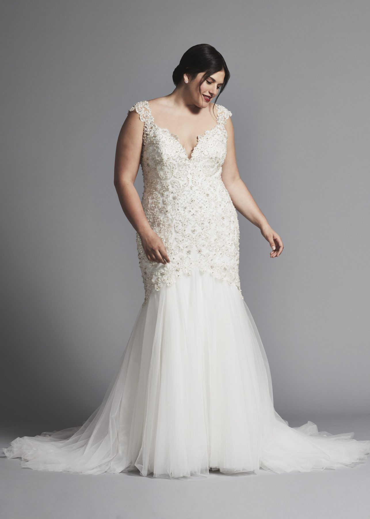 Mermaid wedding dress with beaded bodice and tulle skirt available in plus  size.  189b28785b2a