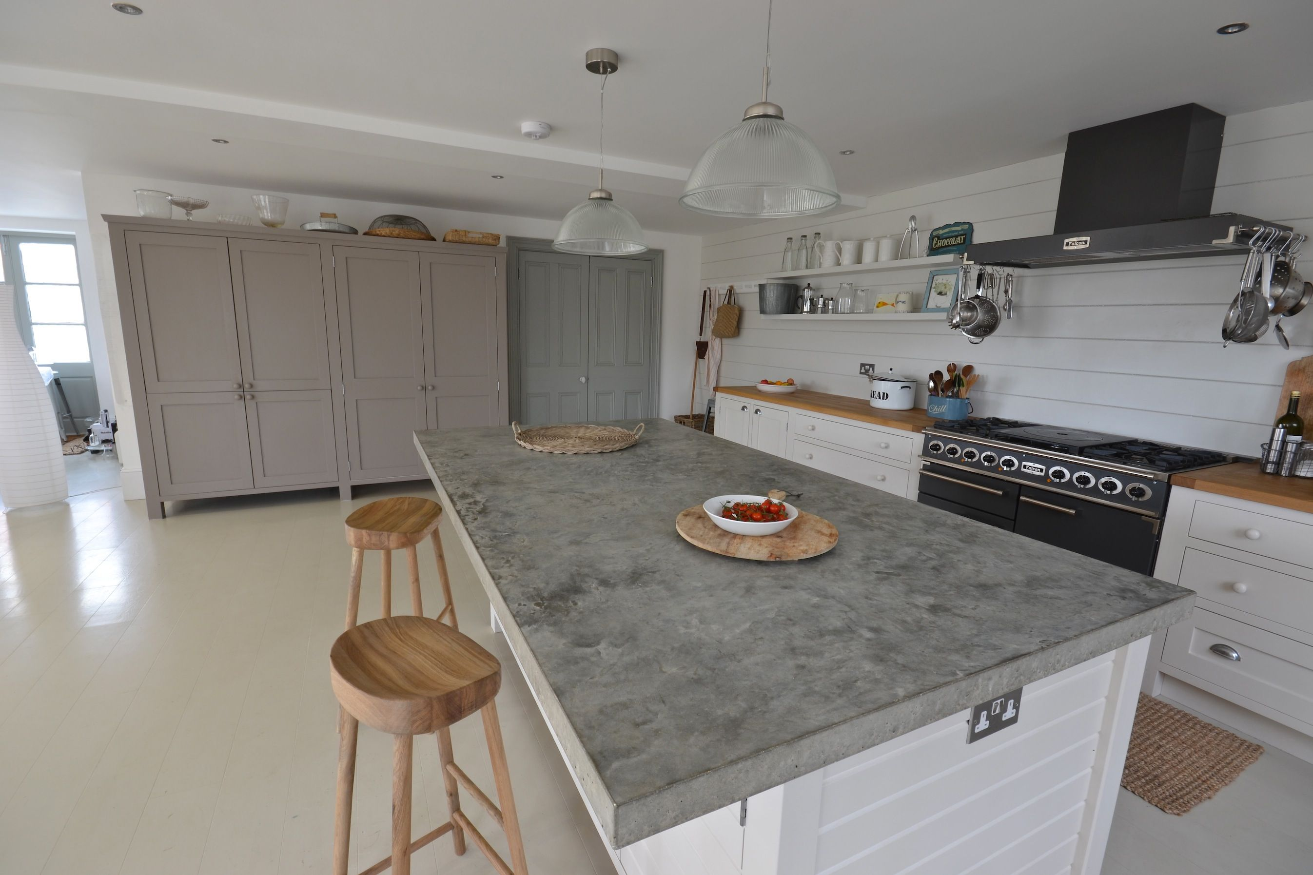 hand trowelled polished concrete worktop with sloped drainer and
