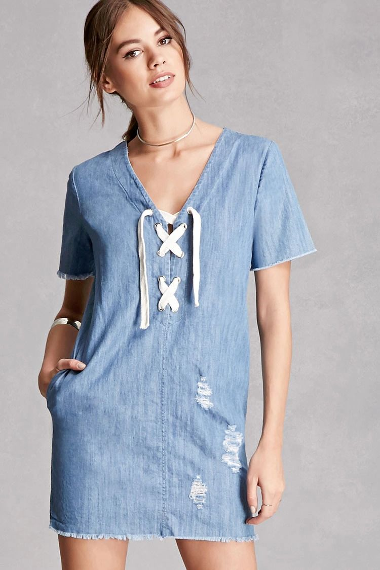 d3adf96e7f78 A knit denim mini dress featuring a V-neckline with a lace-up front, side  seam pocket, a distressed style, short frayed sleeves, and a frayed hem.