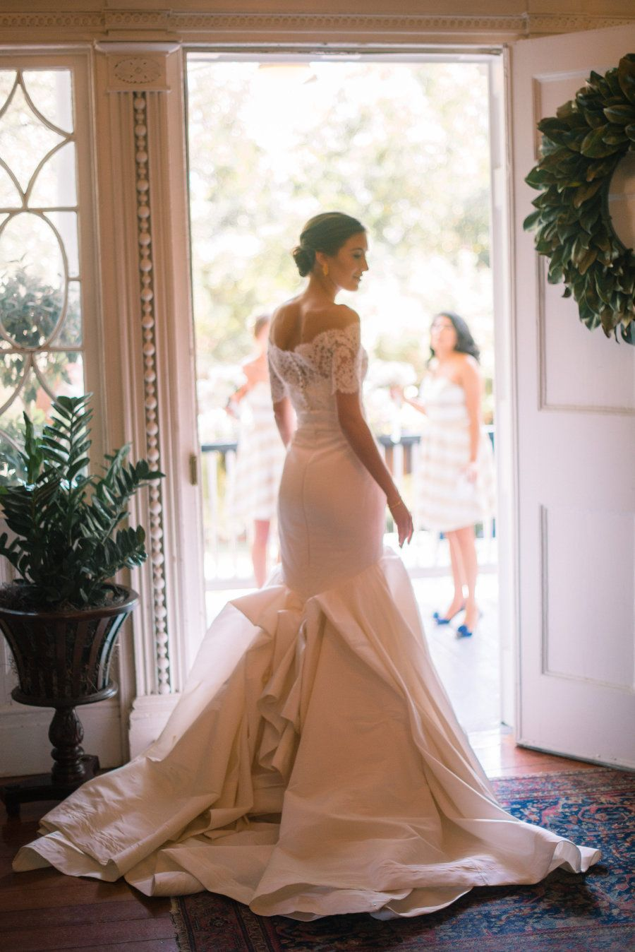 Chic mermaid Carol Hannah wedding gown: Photography : Tim Will Fine Art Weddings and Portraits Read More on SMP: http://www.stylemepretty.com/south-carolina-weddings/charleston/2016/12/08/governor-house-wedding/