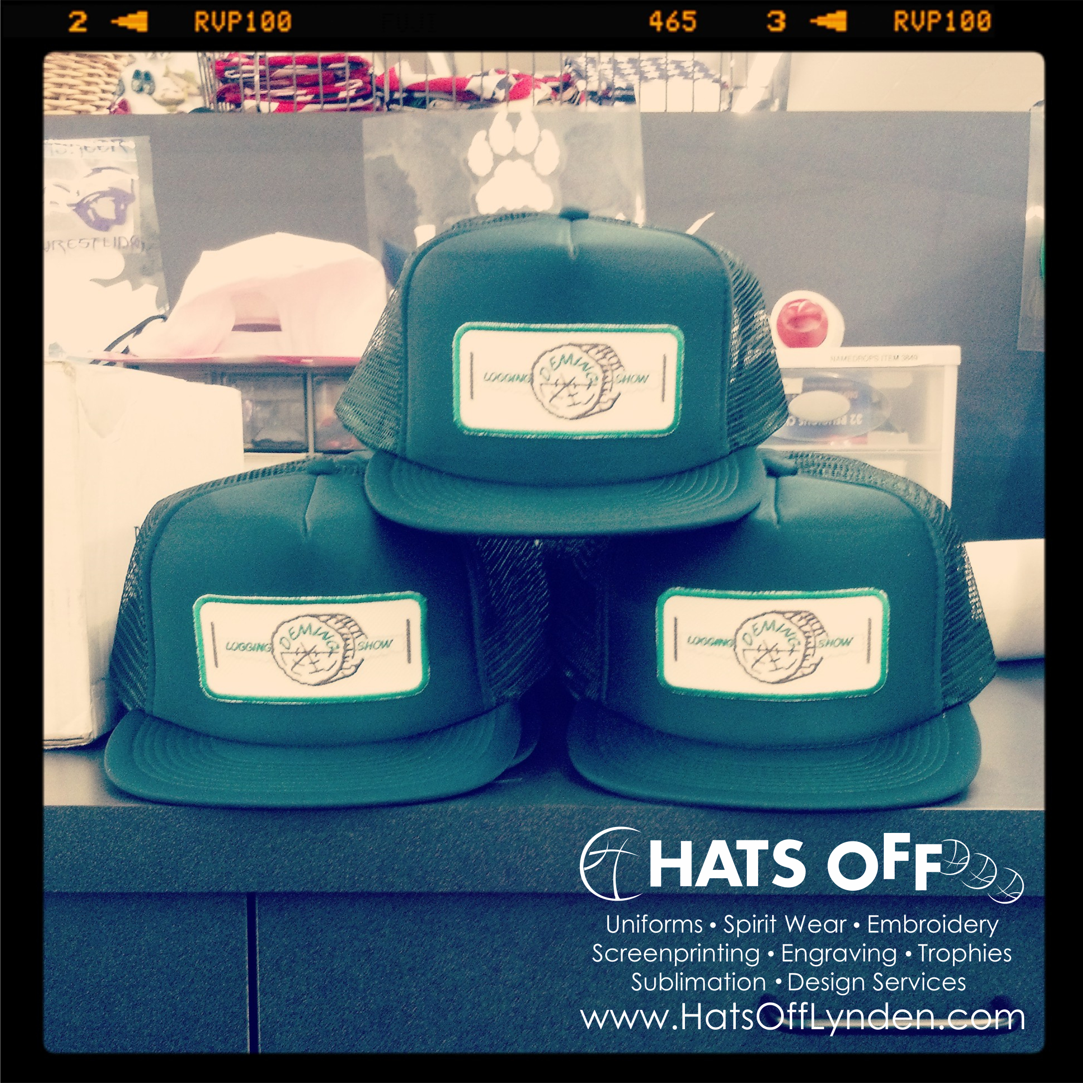 08205c19a154f Deming Logging Show custom embroidered forest green foam trucker hats.