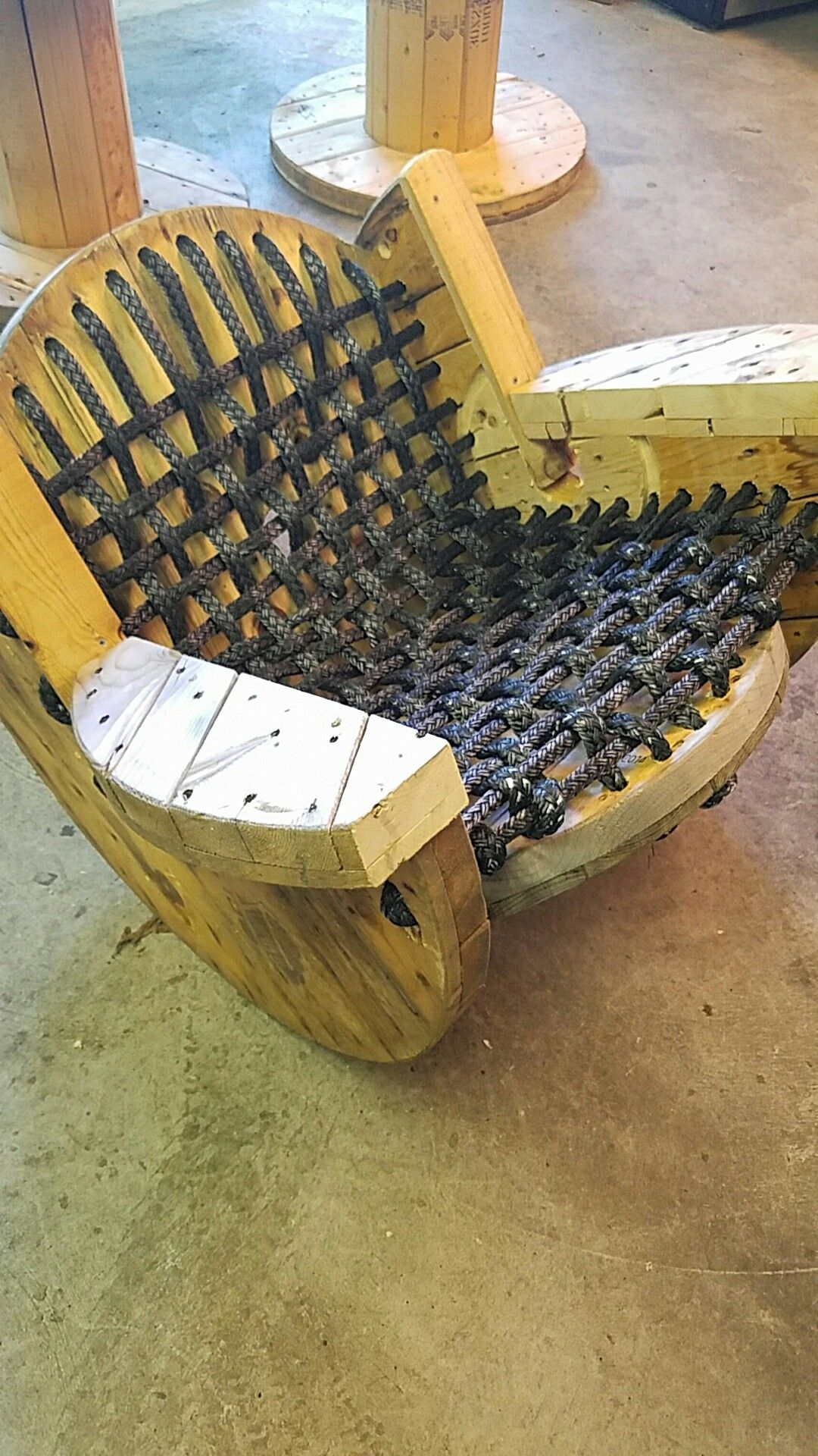 Recycled Wood Reel Turned Into A Rocking Chair, Woven
