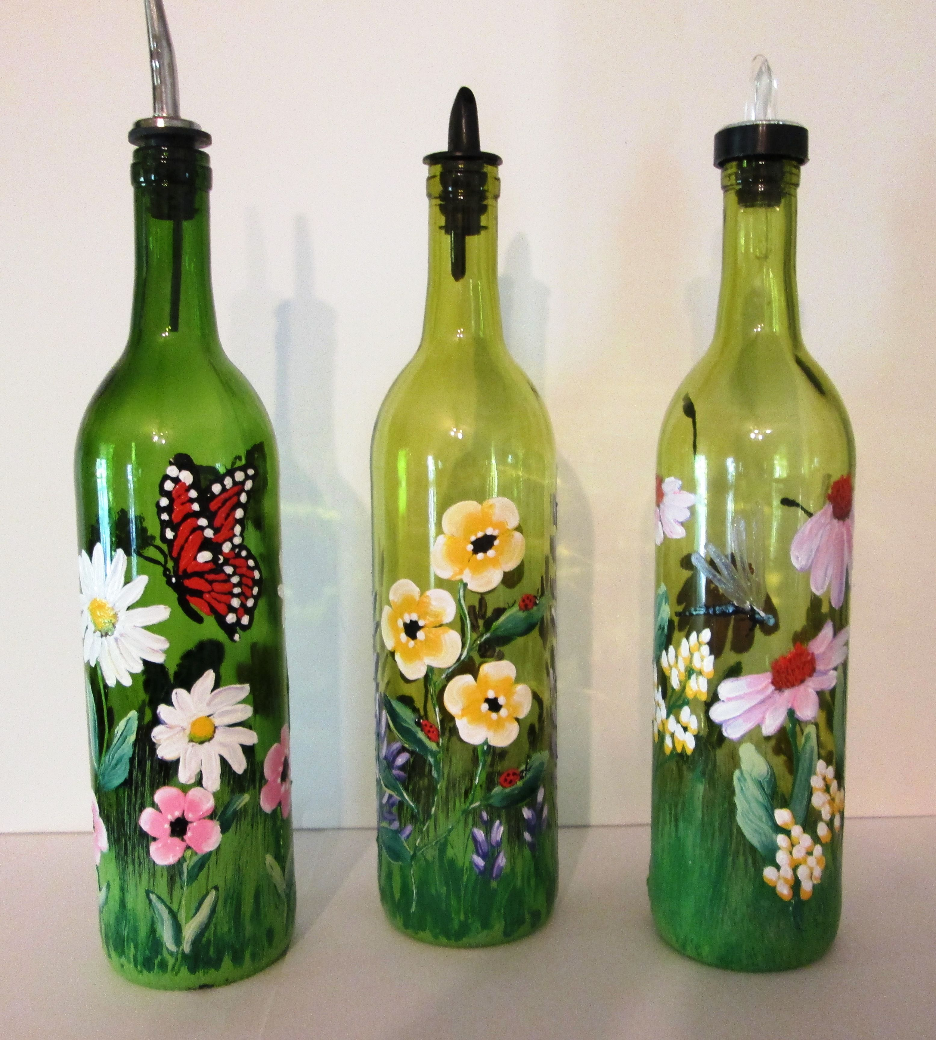 vibrant painted wine bottles with butterflies lady bugs