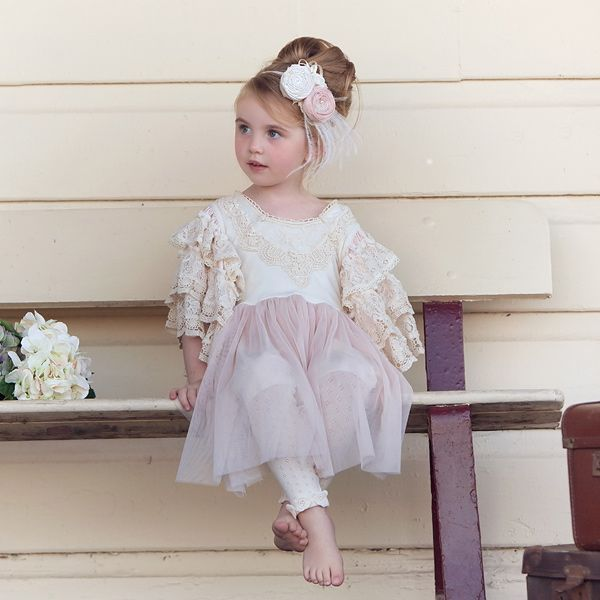 Dollcake Lace Cake Dress $145.00 CAD  A very cute little party dress that can be worn in both Summer and Winter. The sleeves are very full with 3 layers of frilled cotton lace then edged again in more lace to give a lovely finish.The front chest features a cotton applique with pink tulle skirt attached. Available in store at Le Petite Putti Toronto Canada or online www.lepetiteputti. com
