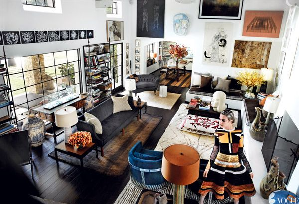 Mario Testino's LA Home via Vogue (Mauritanian leather–stitched straw mats and rugs from Marrakech; Peruvian glazed pottery; art by Friedrich Kunath, Thomas Houseago, and Sergej Jensen; Proenza Schouler printed raffia knit top and skirt)
