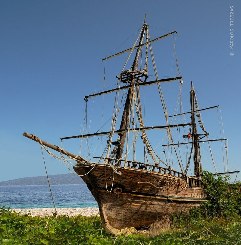 An Old Wooden Two Masted Sailing Ship Run Aground In Her Last Anchorage By
