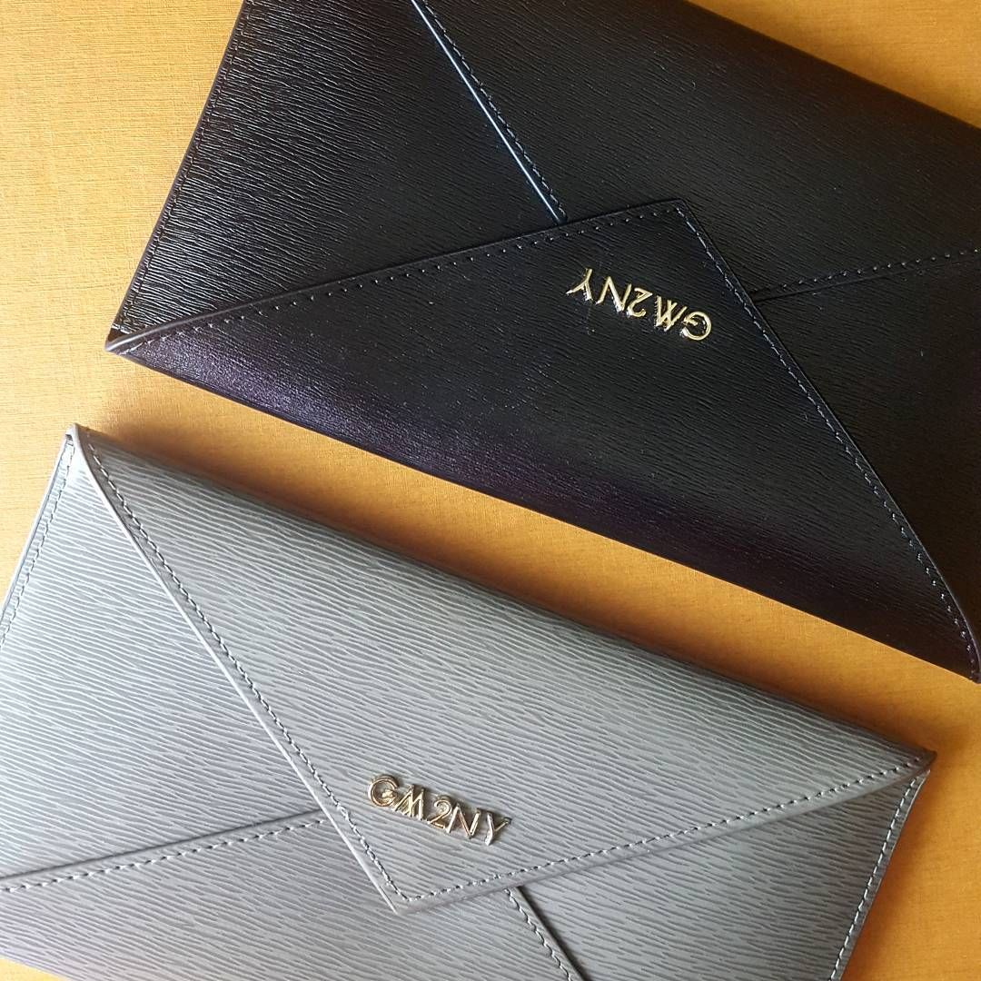 Brushed leather envelope purses fit all your essentials - coins, passport, iphone. Perhaps the perfect gift for a traveling friend? #martihandbags
