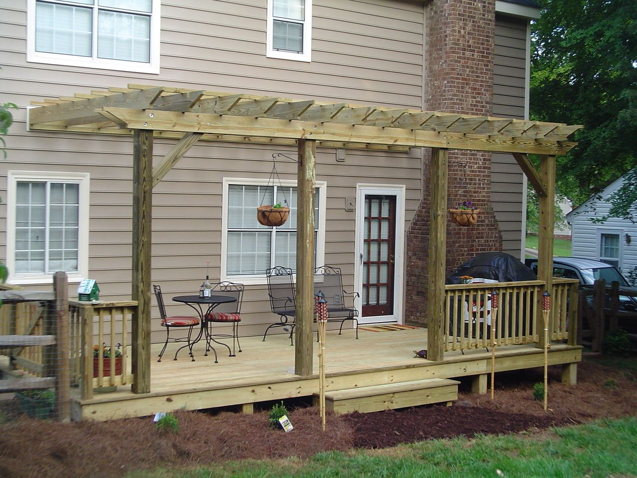 Backyard decks and patios treated deck composite for Small house deck designs