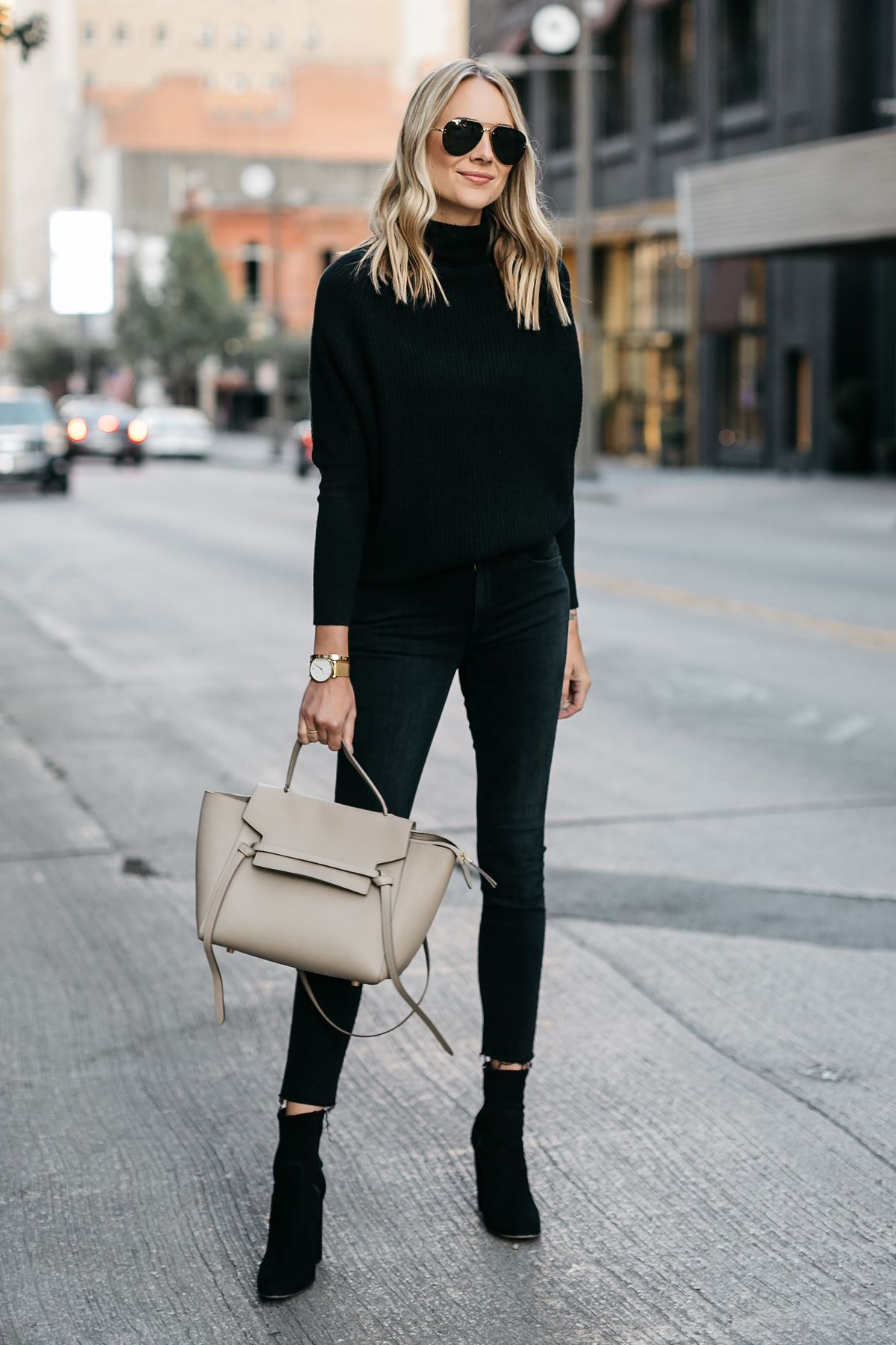 Blonde Woman Wearing Club Monaco Black Cashmere Sweater Black Skinny Jeans  Black Booties Celine Mini Belt Bag Fashion Jackson Dallas Blogger Fashion  Blogger ... e0bd9fdd8