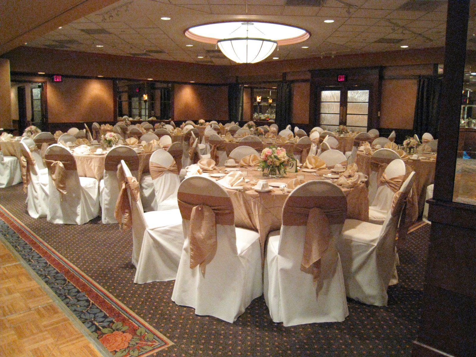 Ivory chair covers with accent tie and table linens would for Wedding reception table linen ideas