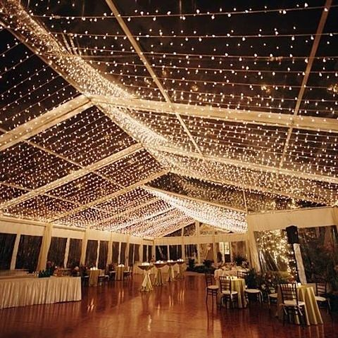 a tent made out of lights perfect for outdoor receptions