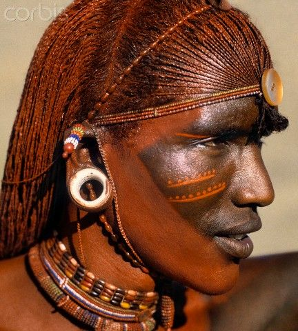 A Samburu warrior resplendent with long, braided, Ochred hair. The round ear ornaments of the warriors are fashioned from ivory. Samburu warriors are vain and proud, taking great trouble over their appearance.   IMAGE: © Nigel Pavitt/JAI/Corbis