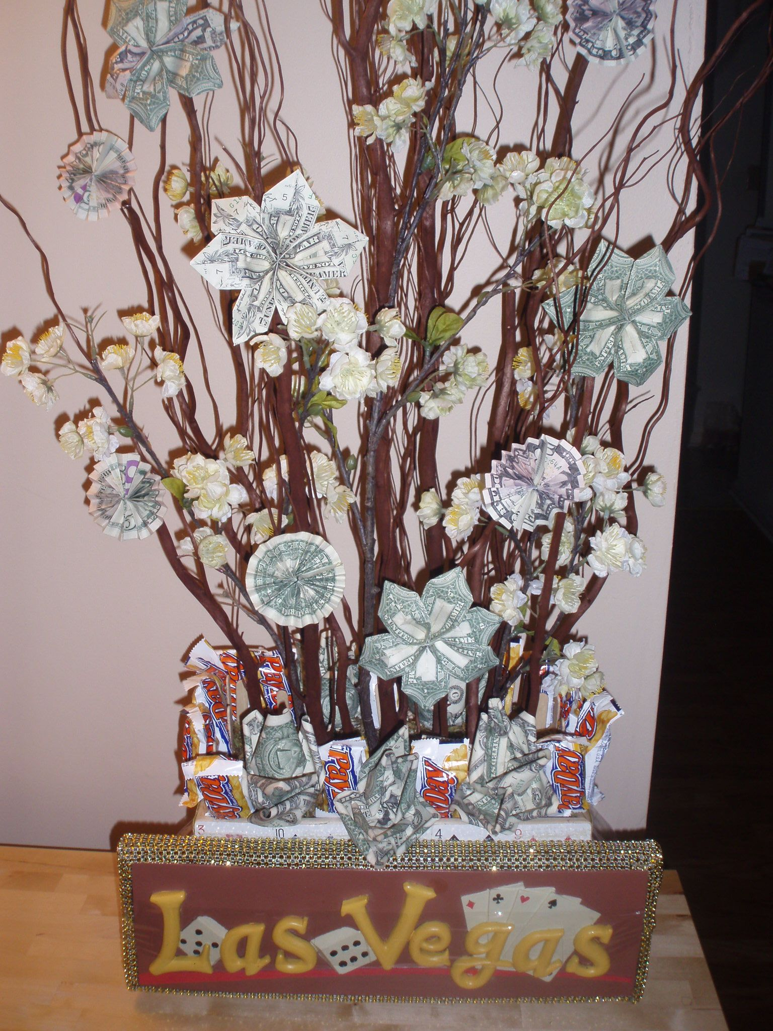 Money tree arrangement for a retirement gift casino theme