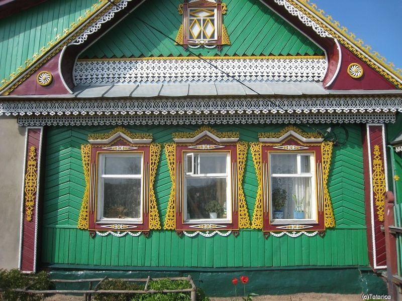 Фото красивого деревянного дома бирюзового цвета в ...