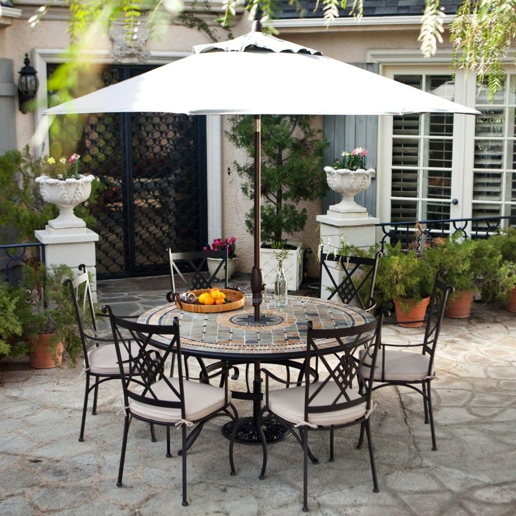Enchanting outdoor patio sets with umbrella above round table and 6 chairs