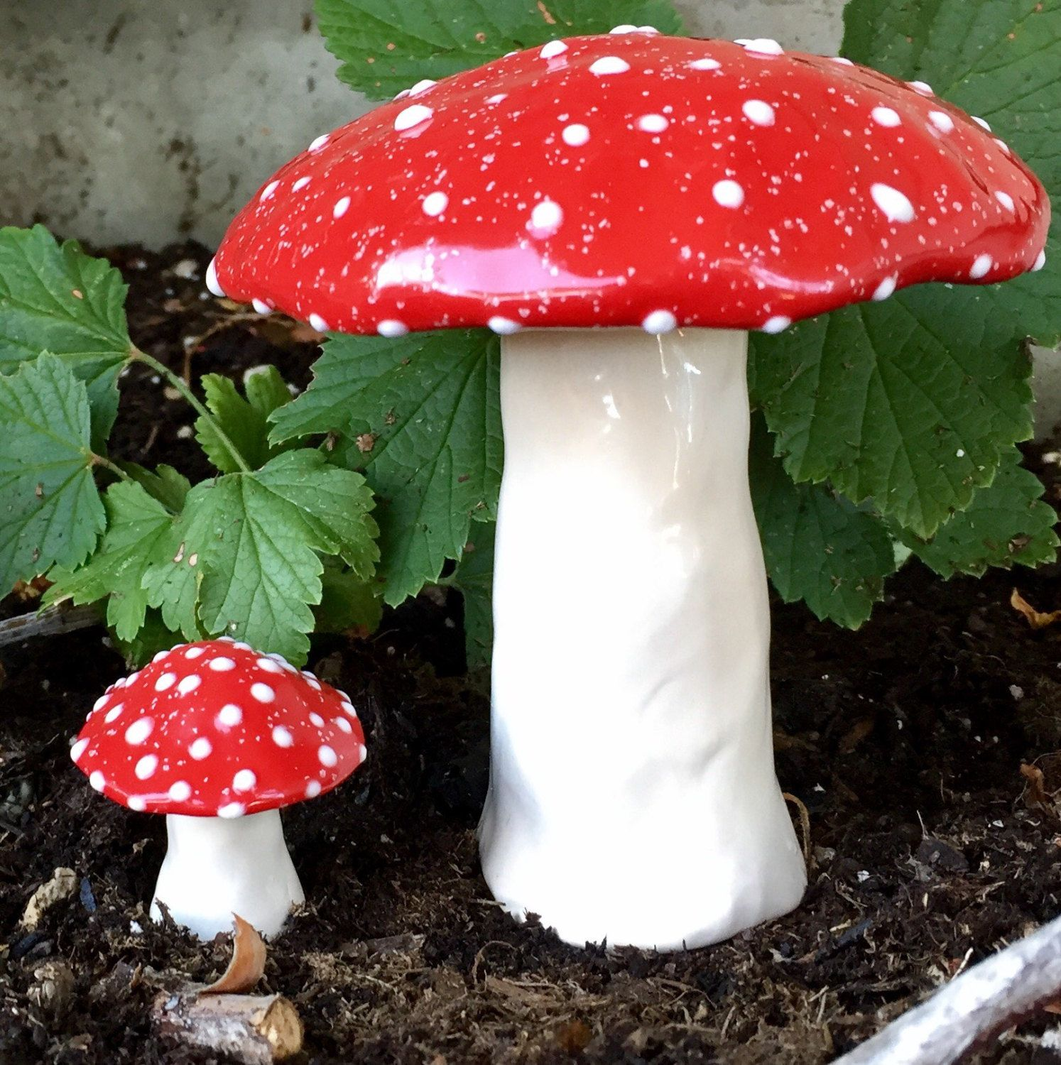 Large handmade ceramic toadstool, and a small ceramic toadstool. T ...