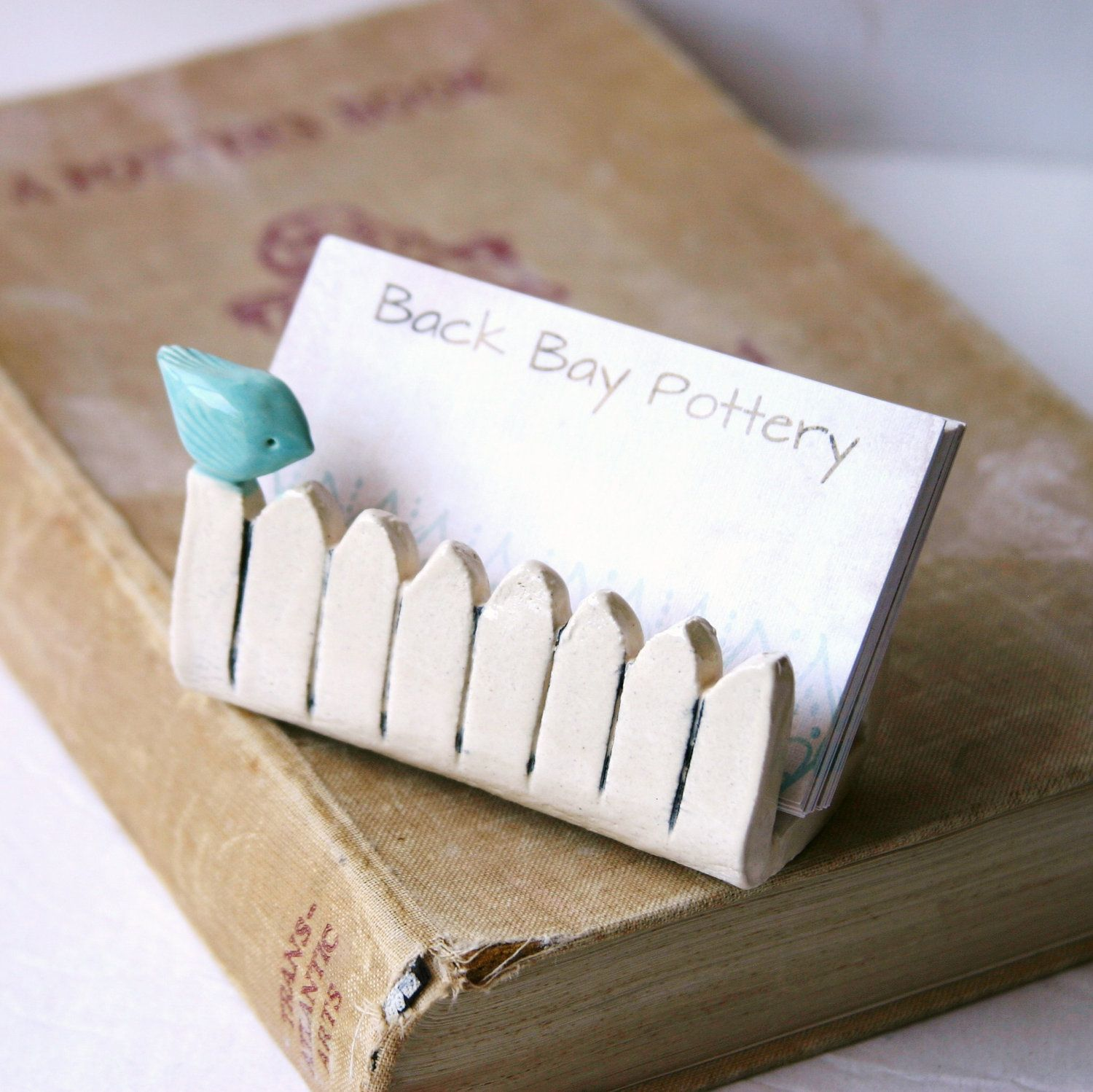 little bird on a white picket fence  ceramic business card holder