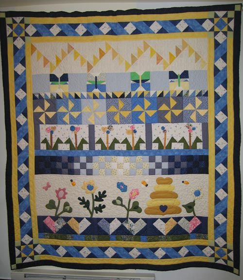 Image from http://www.websterquiltguild.com/img/showandtell/2009/dlester_row_quilt.jpg.