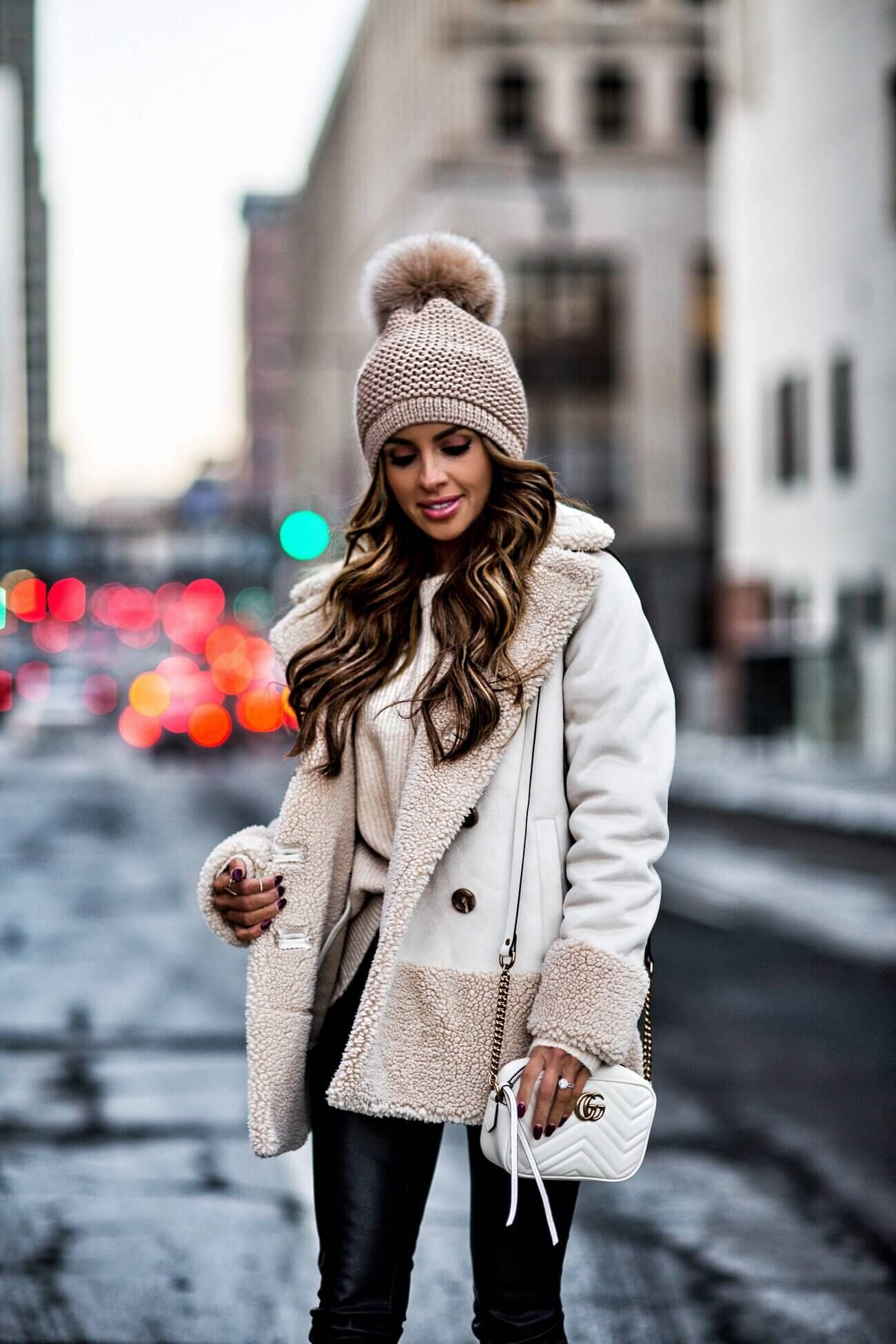 b2d8f9dd368e79 fashion blogger mia mia mine wearing a camel sweater from forever 21 and a  pom pom beanie from bloomingdale's
