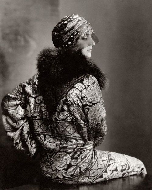 A model poses for Edward Steichen in Vogue (November 1925), wearing an embellished headdress by Suzanne Talbot