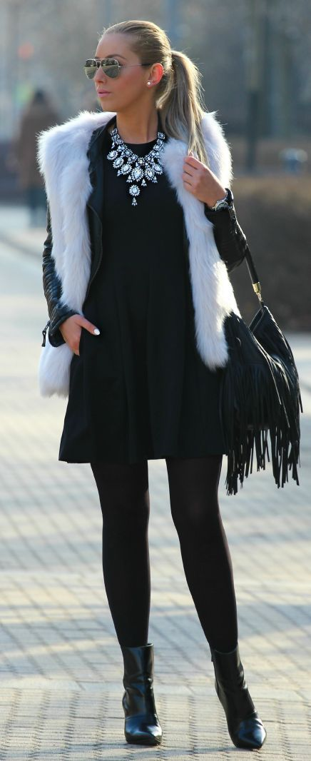 white fur vest and all black