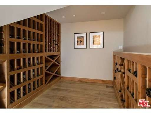This wine cellar has so much storage for all your favorite  types of wine. A great addition to the home of any wine lover #Wine #Cellar #Storage