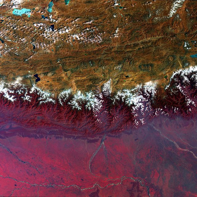 The Himalayan Mountains are a seam on our world, marking a place where continental plates are slamming into a new land. But they're more than that: they also mark the boundary between different climates. That is made explicitly clear in this false-colour satellite image.
