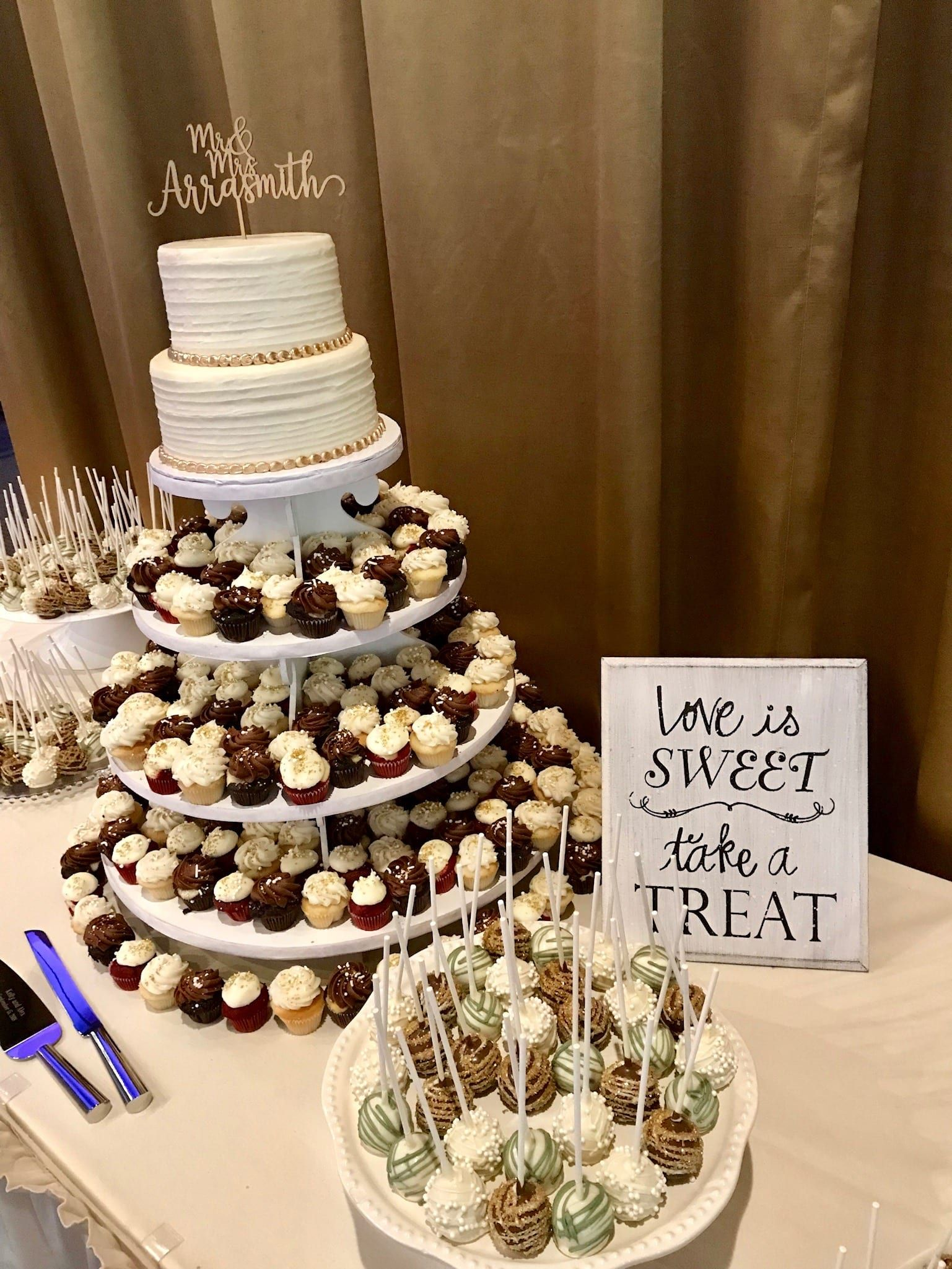 Wedding Dessert Table With Mini Cupcakes Cake Pops And A 2 Tier Cake 3 Sweet Girls In 2020 Wedding Cake Dessert Table Wedding Cupcake Table Dessert Display Wedding