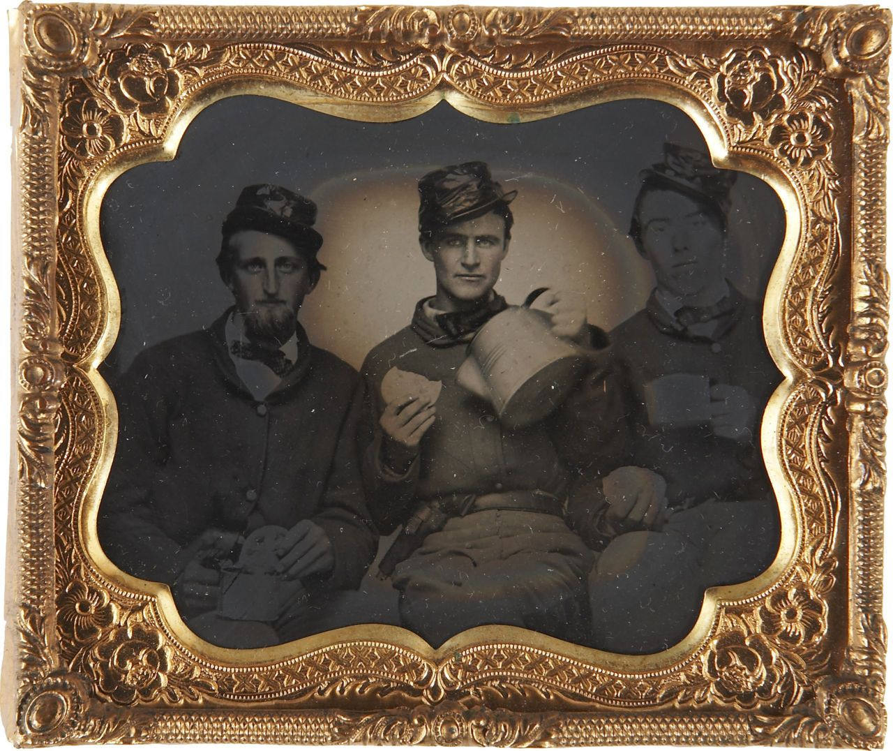 Tintype portrait of three federal soldiers enjoying hardtack and coffee