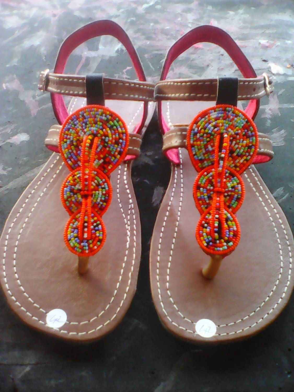 bd6802b1442174 Hand-made Swahili leather slippers with hand beaded artwork by  BITSOFAFRICANCRAFTS on Etsy