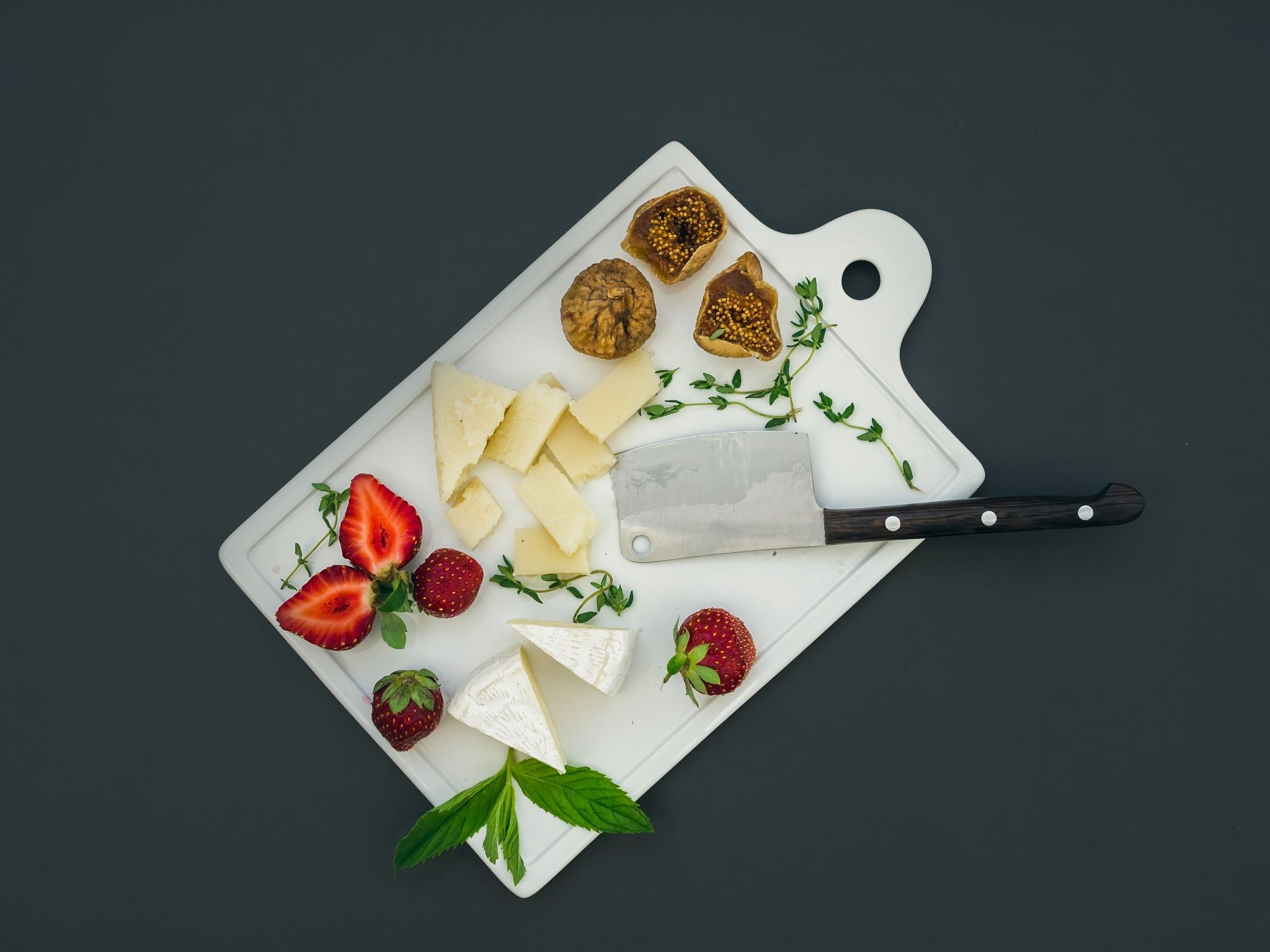 Photograph Cheese and fruit set on a dark surface by Anna Ivanova on 500px