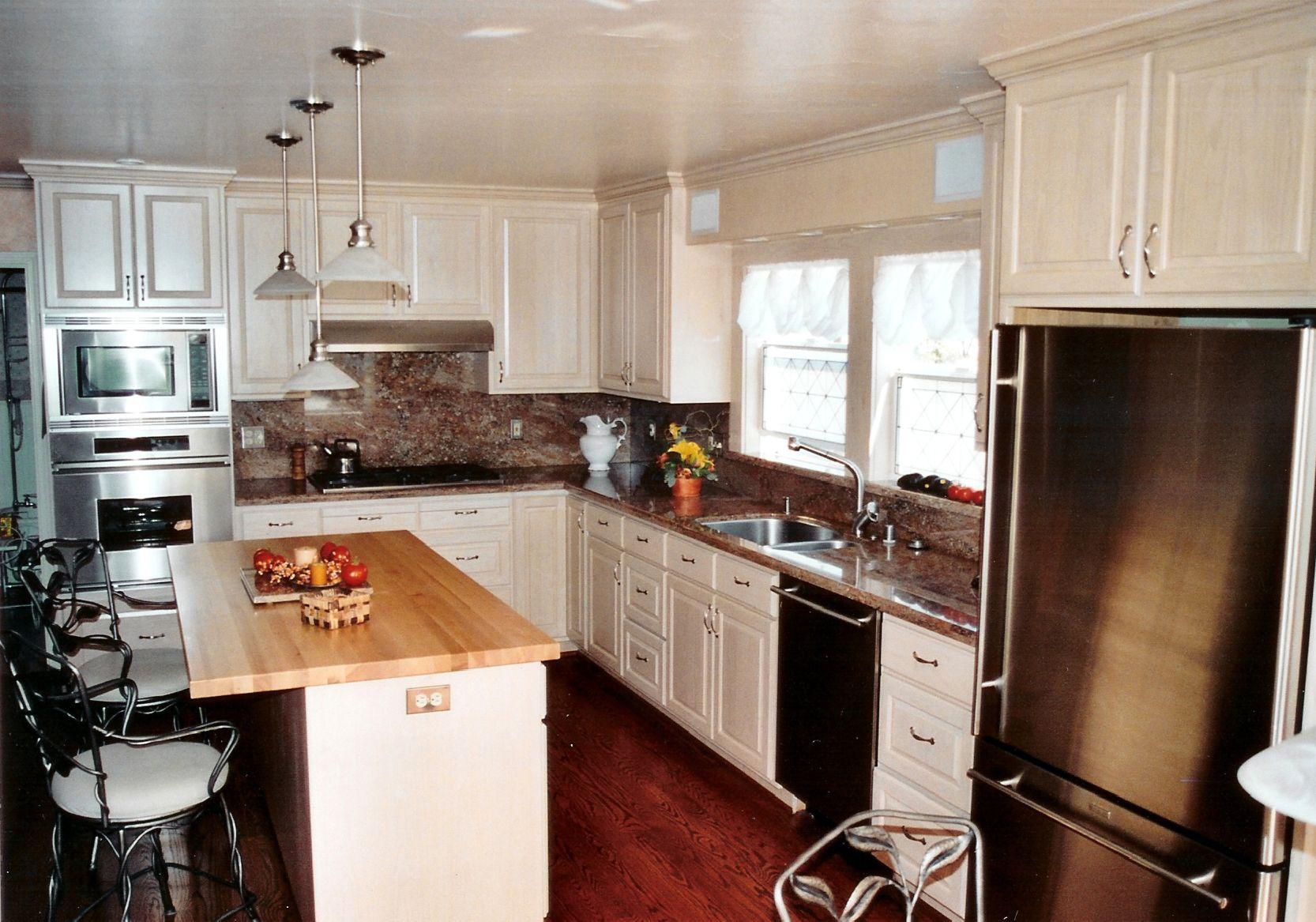gray cabinets and white backsplash kitchen