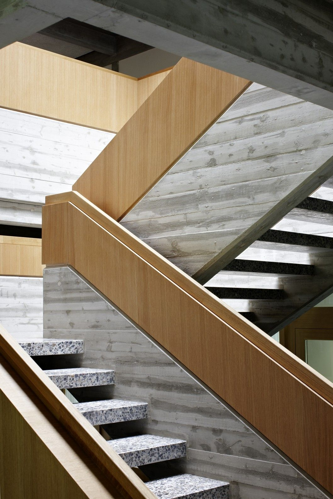 Wood Railing Terrazzo Stairs And Stamped Concrete