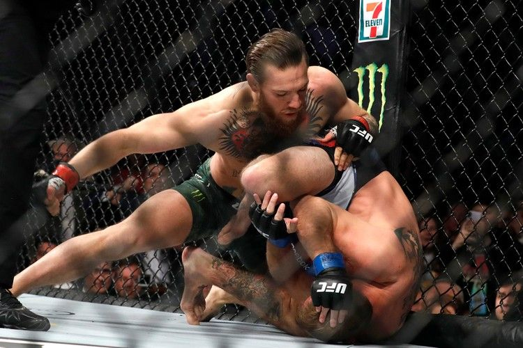 Mcgregor Bests Cowboy In Just 40 Seconds In 2020 Conor Mcgregor Conor Mcgregor Knockout Ufc
