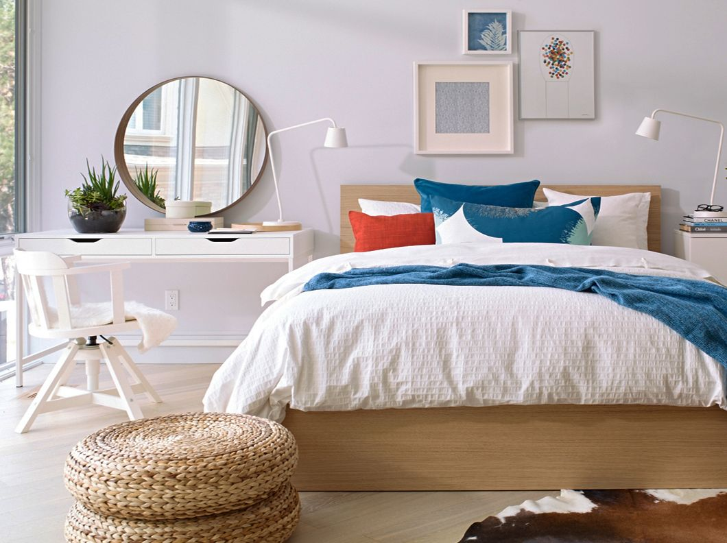 Spring textile lay on a MALM queen bed frame and white