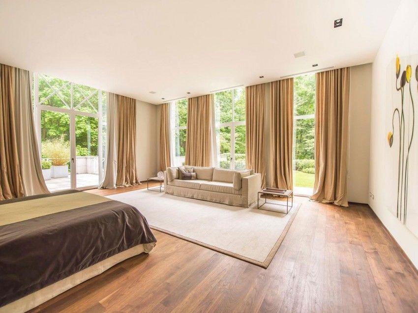 This elegant apartment is located in Watermael-Boitsfort, Brussels, Belgium.
