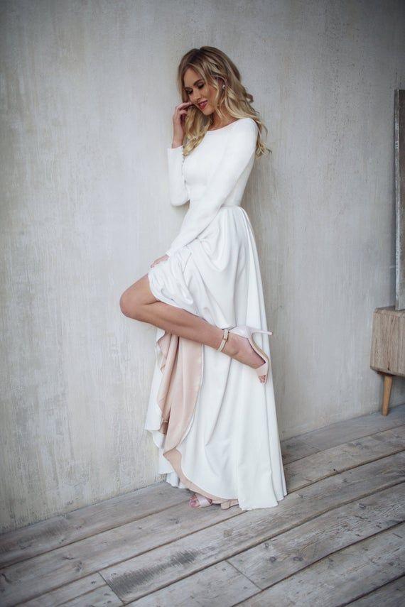 Photo of Simple Dalarna wedding dress, crepe minimalist bran