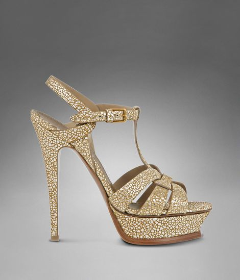 8def01e7278 Check out YSL Tribute High Heel Sandal in Gold Metallic Leather at http://