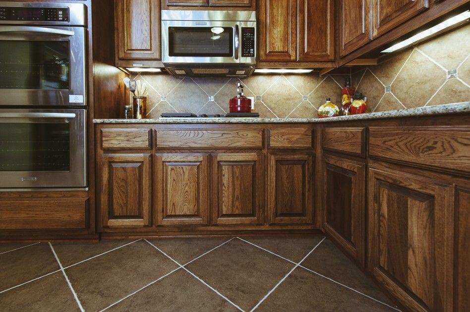 Decorations Elegant Red Oak Kitchen Cabinet Door With Fantastic Brown Kitchen Ceramic Flooring T Kitchen Flooring Kitchen Tiles Design Modern Kitchen Flooring